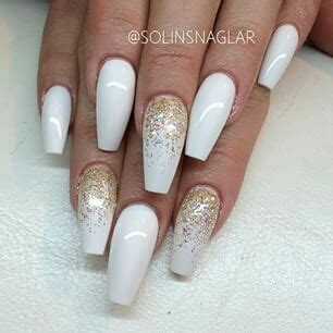White coffin nails with gold glitter on We Heart It