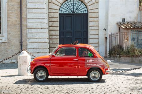 Old Small Red Vintage Car On The Streets Of Rome Italy